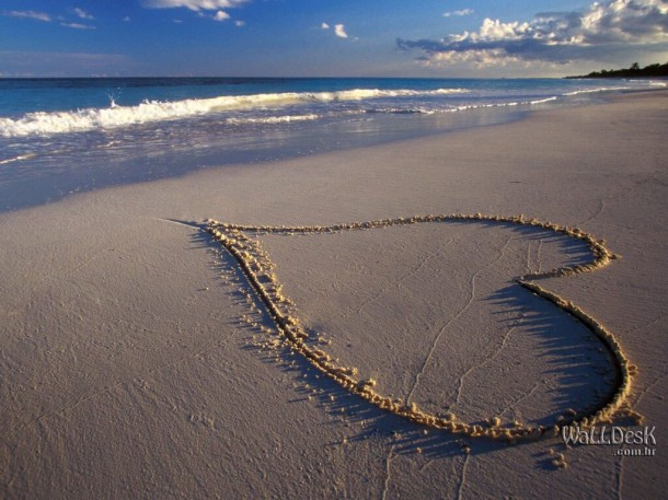 Heart drawn in sand.